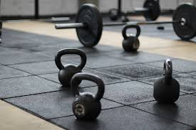 home gym flooring with dumbbells