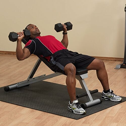 bench pressing on bodysolid weight bench