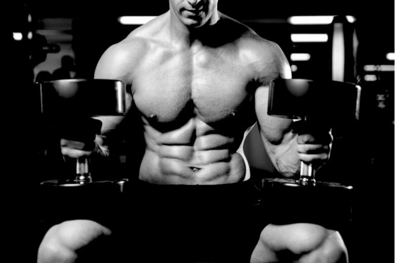 man weight training on weight bench
