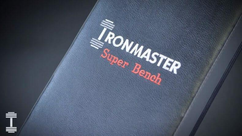 company logo on weight bench iron master