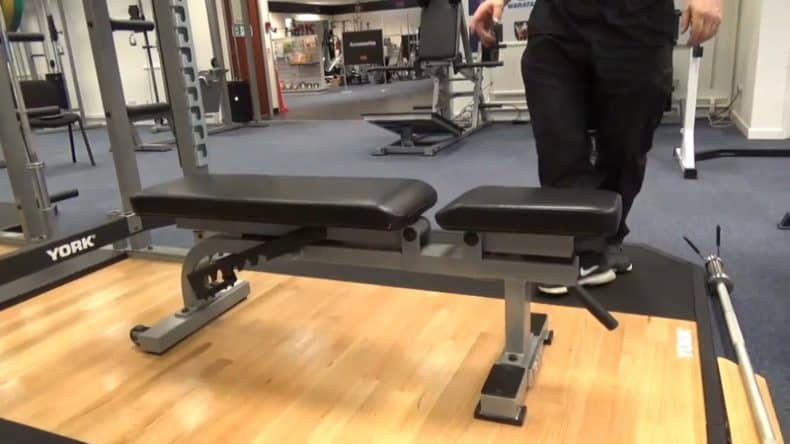 adjustable weight bench in commercial gym on wooden flooring