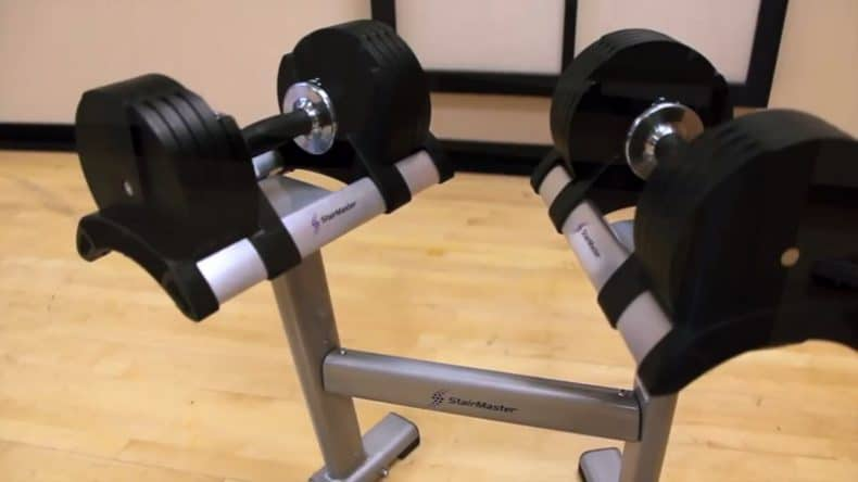 2 stairmaster adjustable dumbbells on stand