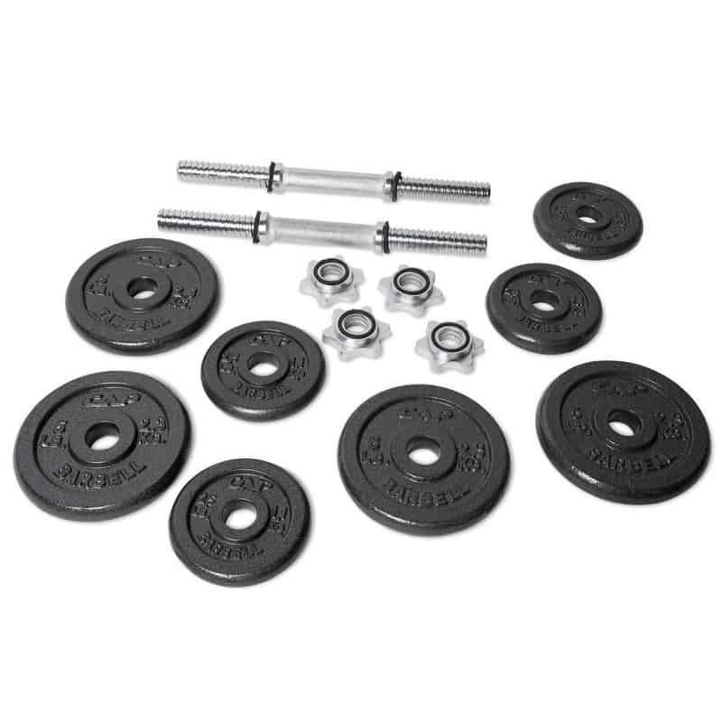 selection of weight plates and dumbbell bar white background