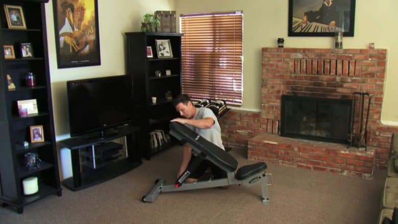 man showing adjust weight bench