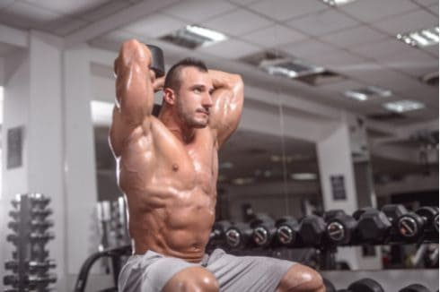 male bodybuilder doing tricep extensions