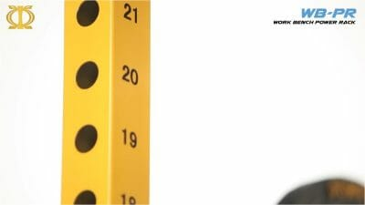 yellow pillar of upright post showing numbers space holes of power rack