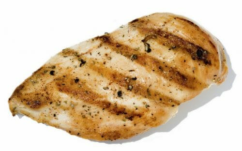 one grilled chicken breast on white background