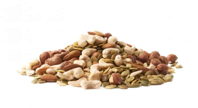 selection of nuts and seeds on white background