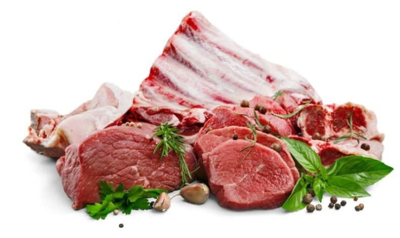 5 different uncooked meats on white background