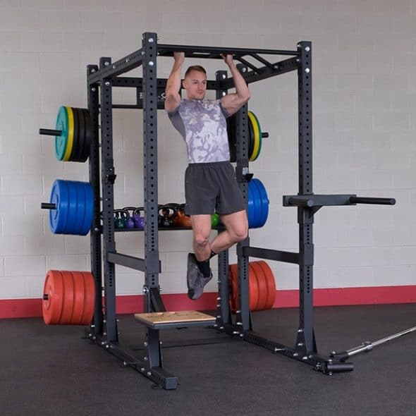 man performing chin up on Body-solid spr 1000
