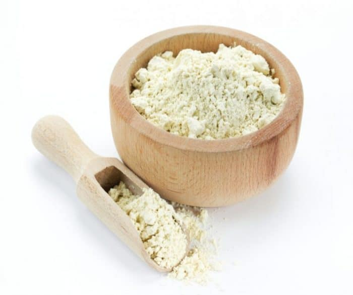 whey powder in wooden serving bowl