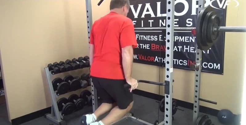 man performing dips outside valor power rack