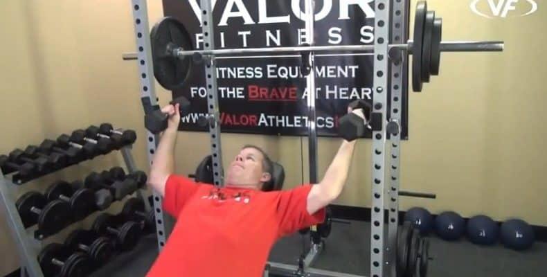 man using dumbbell supports for valor rack