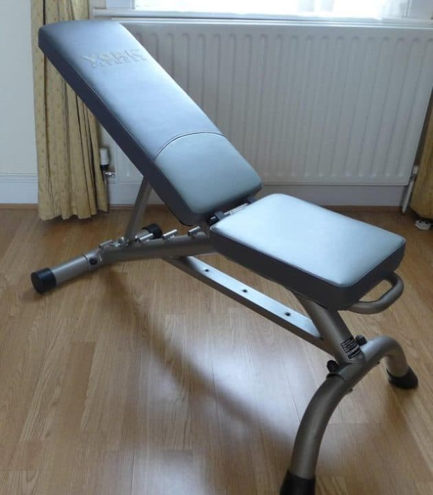 york weight bench on wooden floor in incline position