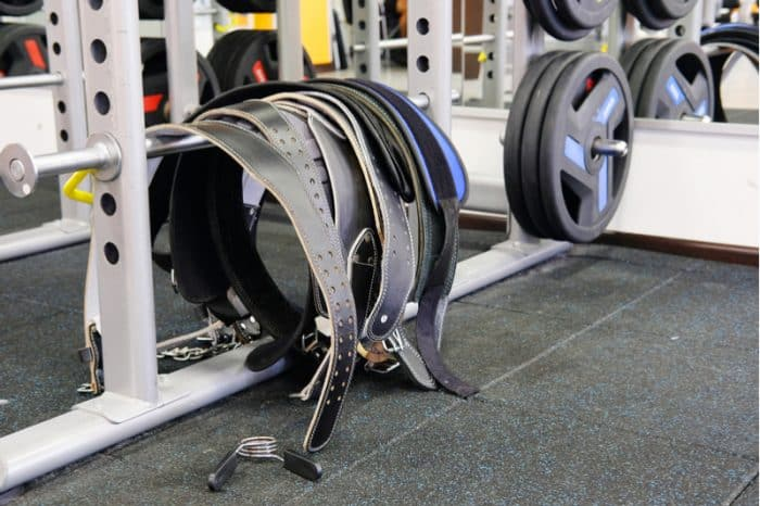 selection of weight belts in the gym