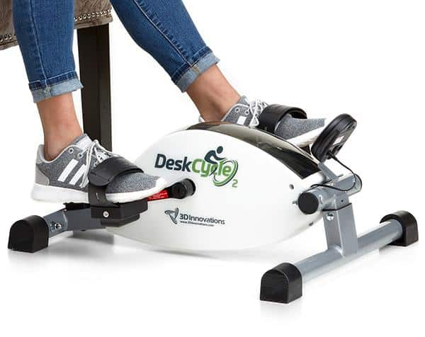 woman exercising on desk cycle 2