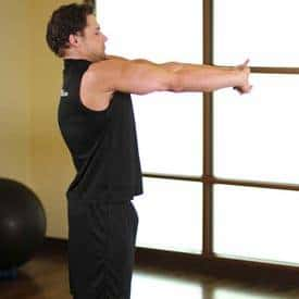 man performing upper arms stretch