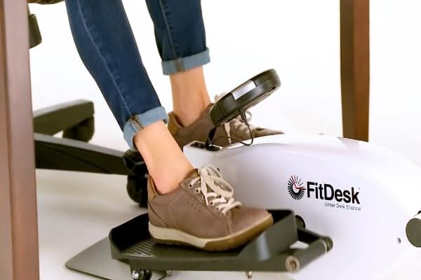 women exercising on under desk elliptical