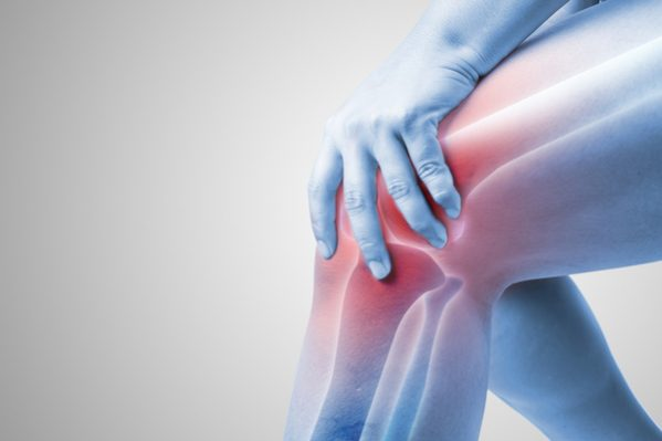 man holding painful knee joint
