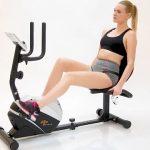woman exercising on recumbent bike