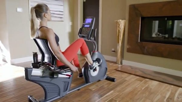 women watching tv while exercising on schwinn 270 recumbent bike