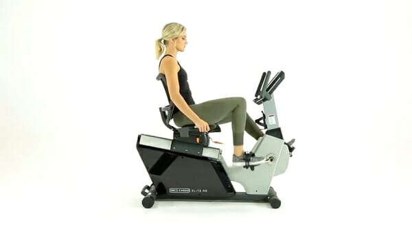 woman exercising on recumbent exercise bike at home