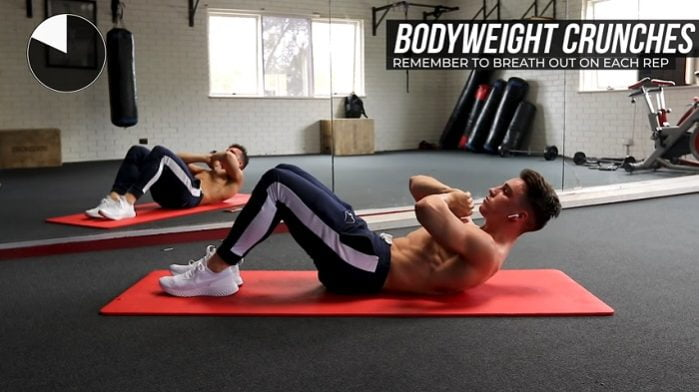 young guy performing bodyweight crunches