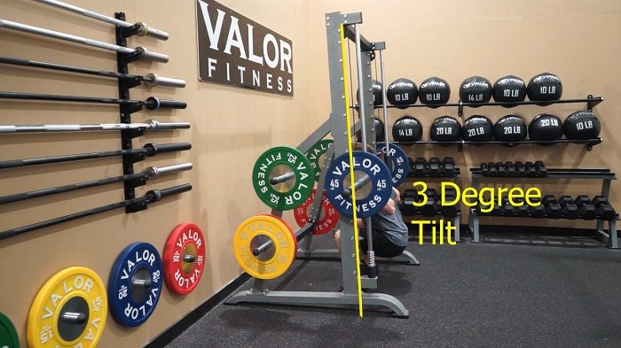 man performing squats using valor fitness smith machine