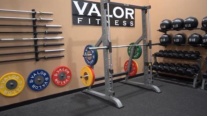 valor fitness smith machines loaded with weight plates