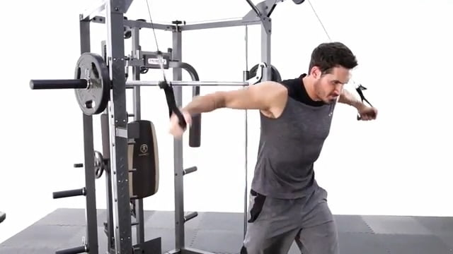 man performing cable flys on marcy combo smith machine