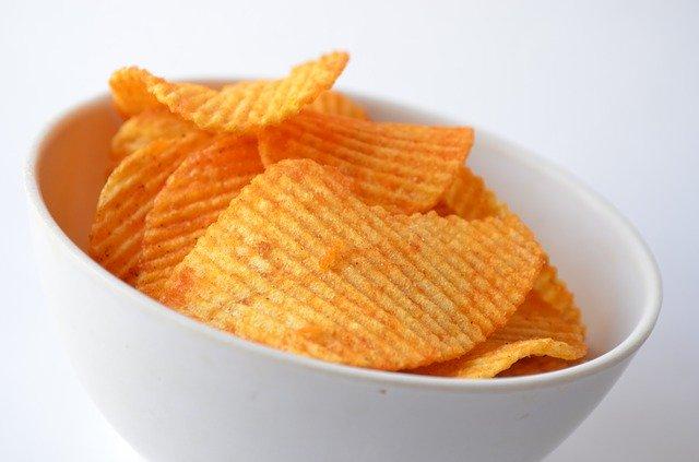 white bowl full of crisps