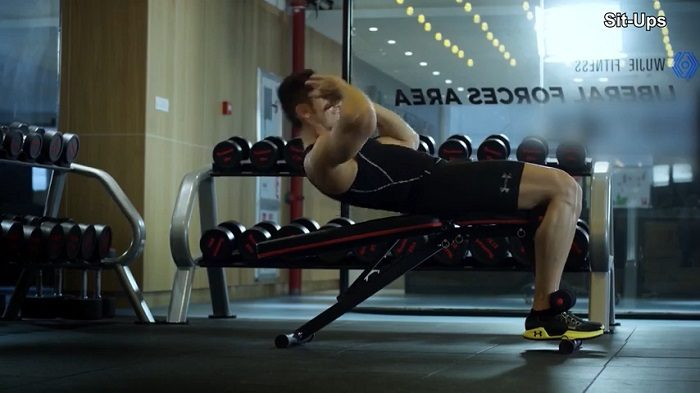 man performing decline sit ups on yoleo weight bench