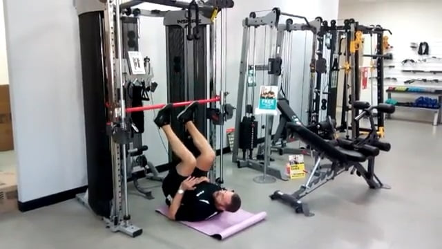 man performing leg press using inspire fitness ft2