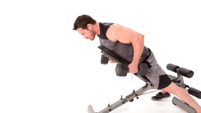 man performing incline dumbbell rows on marcy utility bench