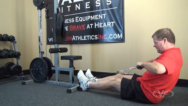 man performing seated cable row on valor fitness CB-12 lat machine