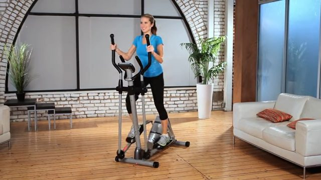 woman exercising on elliptical in filming studio