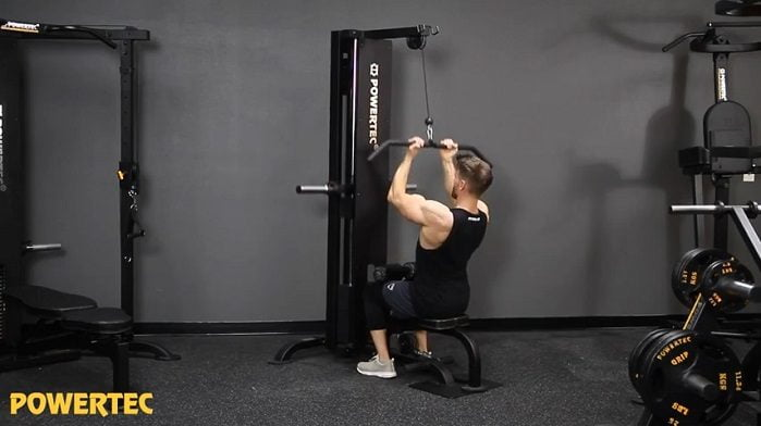 man performing close grip pulldowns on powertec lat pulldown machine