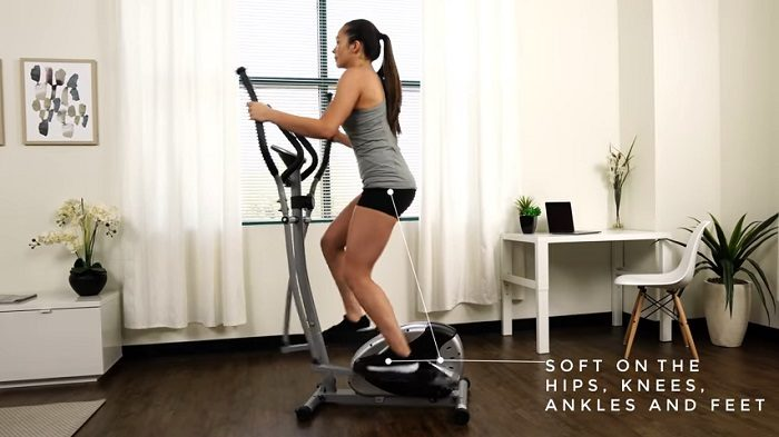 woman exercising on sunny SF-E905 elliptical trainer