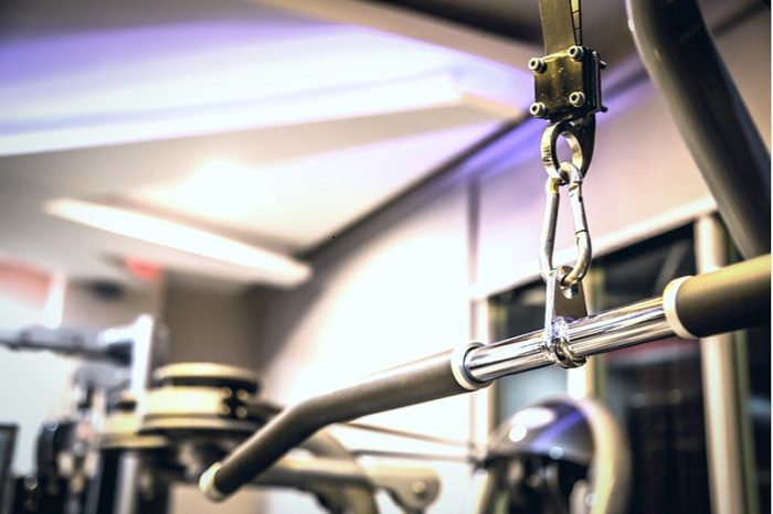 close up of lat pulldown bar in a home gym