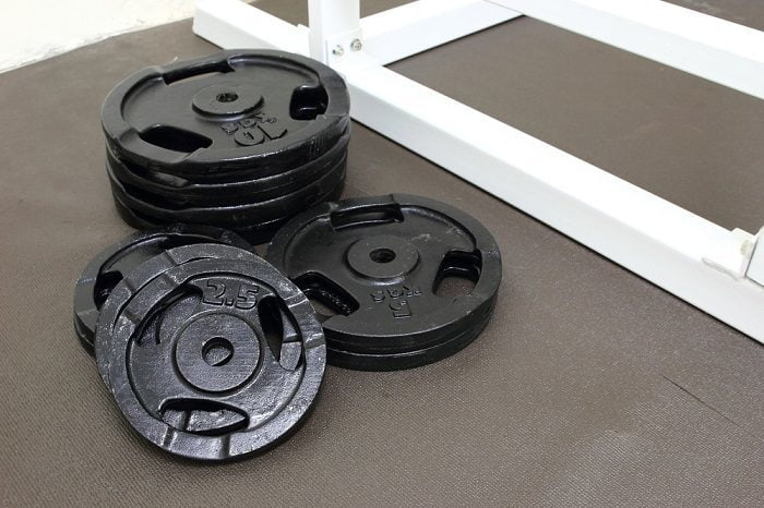 selection of weight plates on gym floor