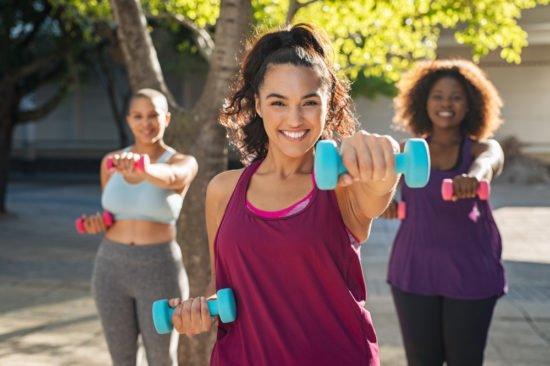 young women doing fat burning workouts outdoors