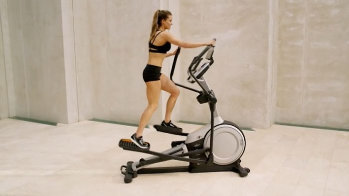 woman exercising on front drive nordictrack elliptical