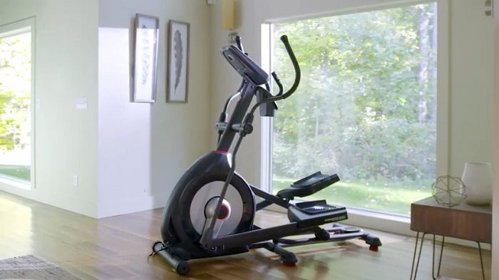 Schwinn 470 elliptical in front room of house