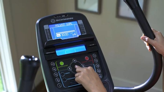 woman demonstrating the advanced monitor of the Schwinn elliptical