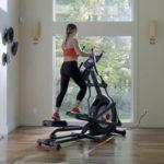 woman exercising on schwinn 470 elliptical trainer