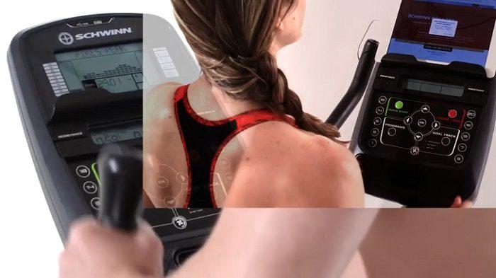 woman selecting resistance levels on schwinn 430 elliptical