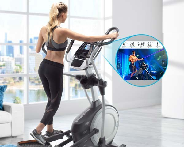 woman exercising on c 9.5 elliptical at home