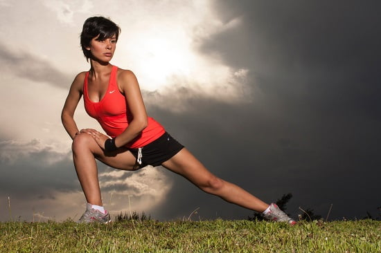 young fit woman exercising outdoors