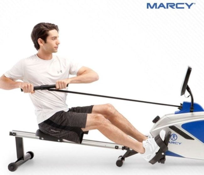 man rowing on marcy rowing machine