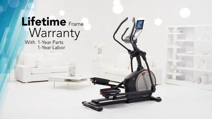 proform 720 e elliptical trainer in front room of home